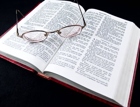covetous: The Bible opened to the Book of Proverbs with Glasses