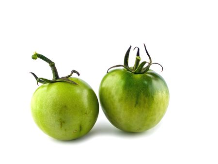 unripened: Two Green, Unripened Tomatoes Isolated oh White Stock Photo