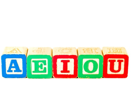 Colorful Alphabet Blocks With All of the Vowels photo