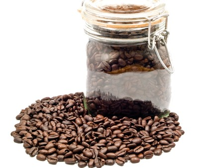 Coffee Beans and a Clear Glass Container with more Coffee photo