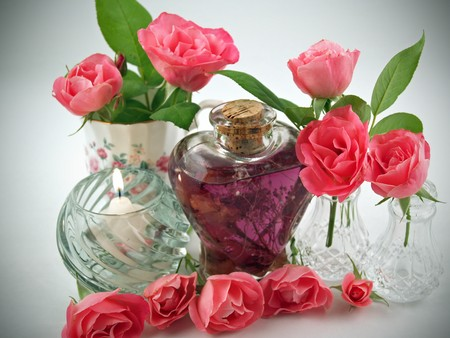 Soft Pink Roses Arranged with Massage Oil in a Romantic Scene Stock Photo
