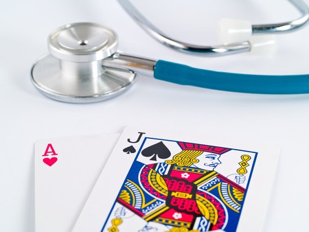 Stethoscope and Playing Cards as a Gambling with your Health Concept Stock Photo - 7574889