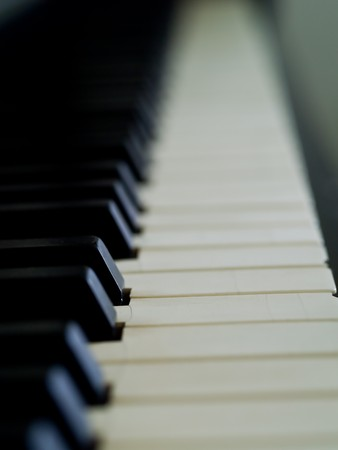 Piano keys of a very well loved and often played piano Stock Photo - 7574773