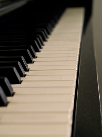 well loved: Piano keys of a very well loved and often played piano in Sepia Stock Photo