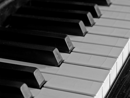 well loved: Piano keys of a very well loved and often played piano in monochrome Black and Whit Stock Photo