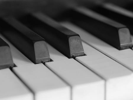 Piano keys of a very well loved and often played piano in monochrome Black and Whit photo