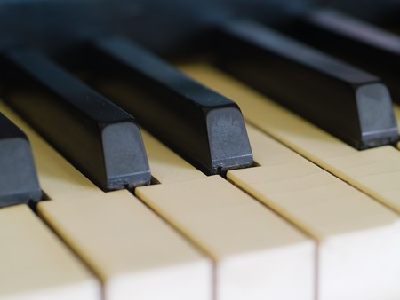 well loved: Piano keys of a very well loved and often played piano