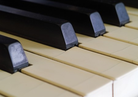Piano keys of a very well loved and often played piano  photo