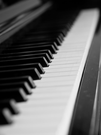 Piano keys of a very well loved and often played piano in monochrome Black and Whit Stock Photo - 7574768