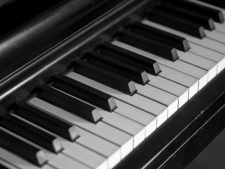 Piano keys of a very well loved and often played piano