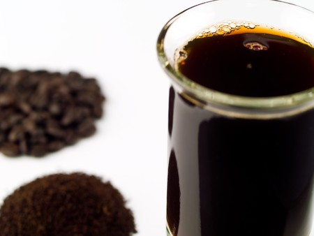 coffee grounds: Coffee Beans Coffee Grounds and a Cup of Brewed Coffee Stock Photo