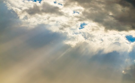 dramatic clouds: Dramatic Cloudscape with Sunbeams Streaming through the Clouds Stock Photo