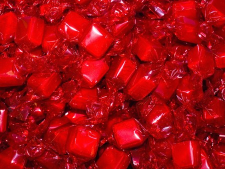 Colorful Hard Candy in Wrappers as a Background photo