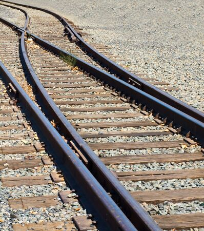 Old Railroad Tracks at a Junction on a Sunny Day photo