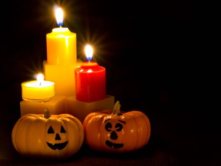 Mini Pumpkins with Funny Faces and Candles photo