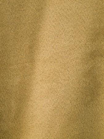 Full Frame achtergrond van Biege of Tan Suede-achtige stof Stockfoto