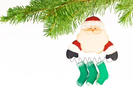 Christmas Tree Holiday Ornament Hanging from a Evergreen Branch Isolated Stock Photo - 8274937
