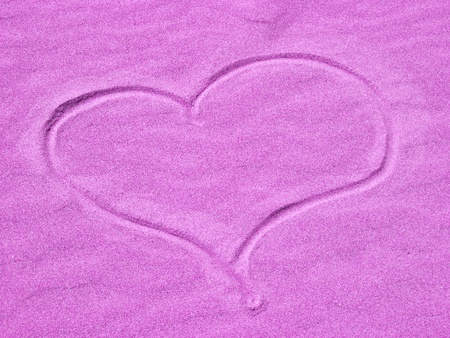 Purple Heart in the Sand on a Sunny Day