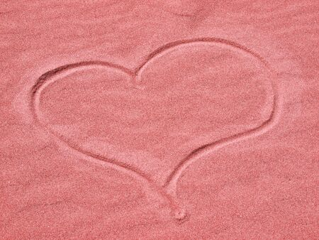 Red Heart in the Sand on a Sunny Day