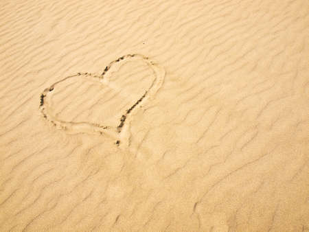 Heart in the Sand on a Sunny Day photo