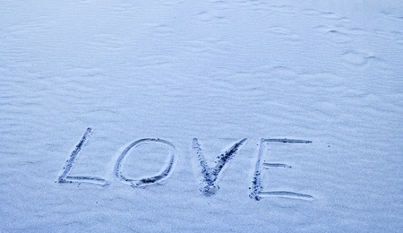 Love Written in Blue Sand on a Sunny Day Stock Photo - 8464227