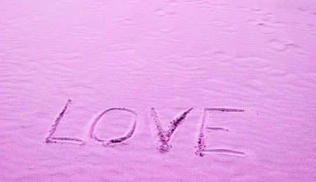 Love Written in Pink Sand on a Sunny Day photo