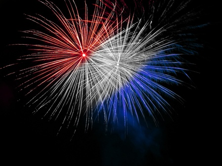 Long Exposure of Red White and Blue Fireworks Against a Black Sky