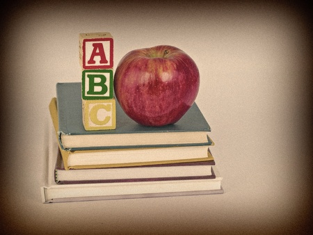 ABC Blocks and Apple on Childrens Books in a Retro Vintage Style photo