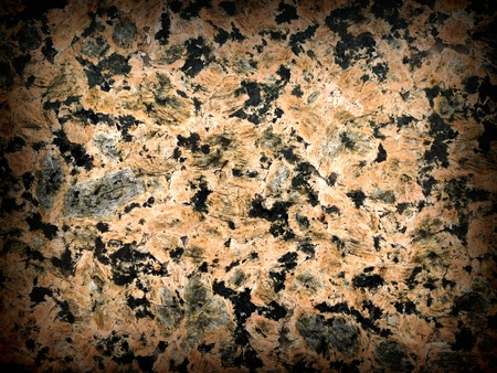 Black and Salmon Colored Marble Surface Texture with Dark Border photo