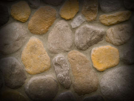 Rock and Concrete Wall with Large Rounded Stones and Dark Border photo