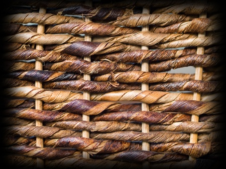 Woven brown wicker basket pattern background texture with dark edge border Фото со стока