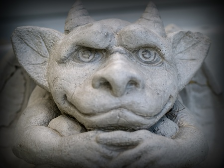 devilish: Gargoyle Statue Emphasis on Face and Eyes with a Dark Border