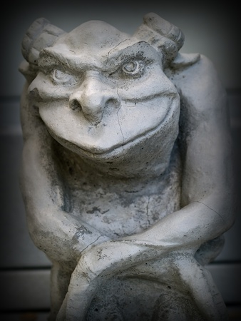 gargoyle: Gargoyle Statue Emphasis on Face and Eyes with a Dark Border