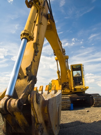 Heavy Duty Construction Equipment Parked at Worksite Stock Photo - 9568239
