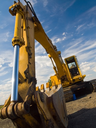 industrial machinery: Heavy Duty Construction Equipment Parked at Worksite