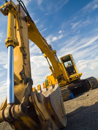 Heavy Duty Construction Equipment Parked at Worksite  photo