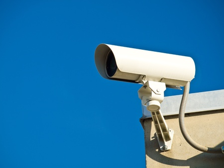 close circuit camera: Security Cameras Performing Surveillance on the Side of a Building Stock Photo