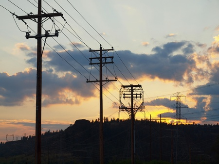 Wood and Steel Power Poles at Sunset in the Country Stock Photo - 9815355