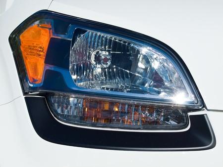 Close Up of a New Car Headlight photo