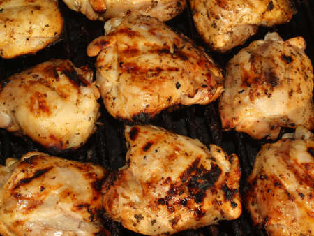 Fresh Grilled Chicken Cooking on the Barbecue photo