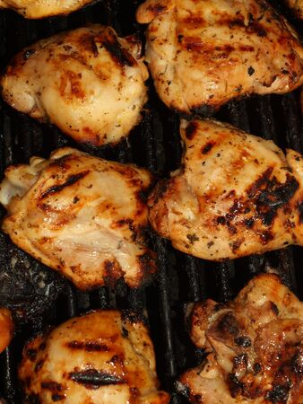 broiled: Fresh Grilled Chicken Cooking on the Barbecue Stock Photo