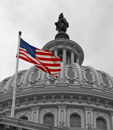 United States Capitol Building in Washington DC in Black & White and American Flag in Color Editorial