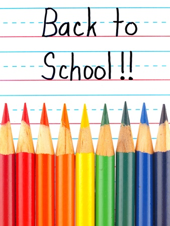 Back to School Written on a Lined Dry Erase Board with Colored Pencils photo