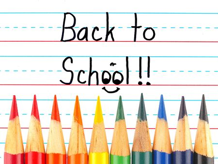 practice primary: Back to School Written on a Lined Dry Erase Board with Colored Pencils