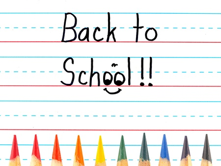 dry erase board: Back to School Written on a Lined Dry Erase Board with Colored Pencils