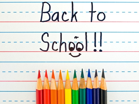 workbook: Back to School Written on a Lined Dry Erase Board with Colored Pencils