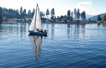 Sailboat Sailing on a Blue Mountain Lake