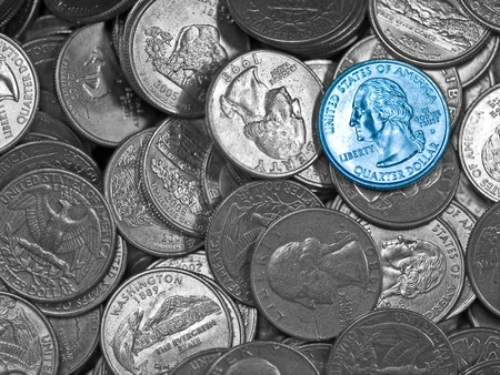 Pile of United States Silver Quarters with a Single Blue One  photo