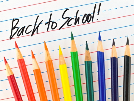 practice primary: Back to School Written on a Lined Dry Erase Board with Colored Pencils  Stock Photo