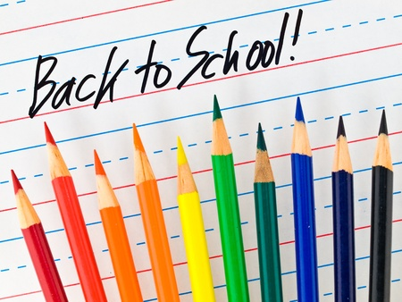 dry erase board: Back to School Written on a Lined Dry Erase Board with Colored Pencils  Stock Photo